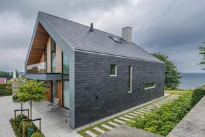 Villa P, maison individuelle design en ardoise naturelle par l'agence danoise Nørkær+Poulsen Architects